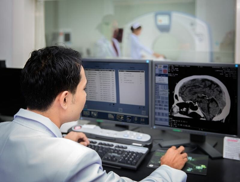radiologist-looking-at-ct-scan